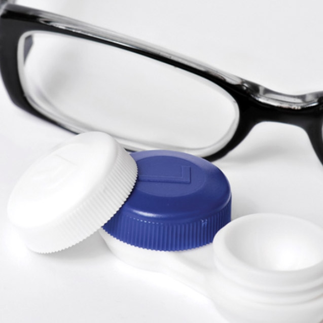shot of glasses and lens cases